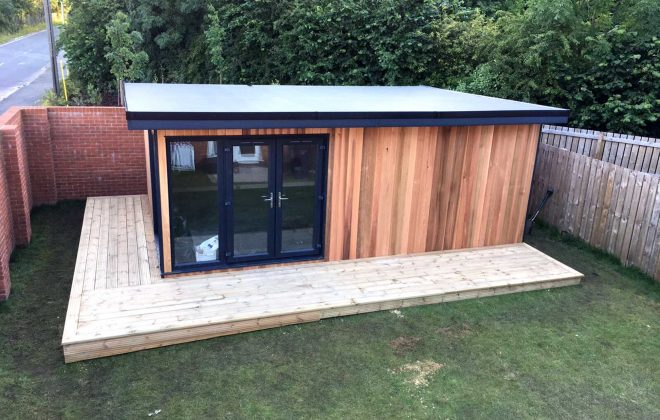 IMAGE 7 Rubber roof glued to SIPS, soffits, fascia trims and gutter fitted